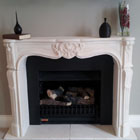 Louis XV stone fireplace