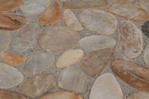 stone pebble paving floor gold colors